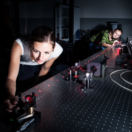 Female scientist doing research in a quantum optics lab Stock Photo