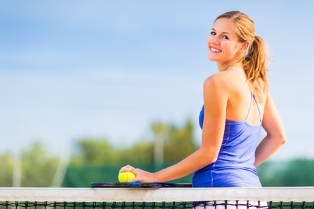 Portrait of a pretty young tennis player with copyspace Stock Photo - 17038554