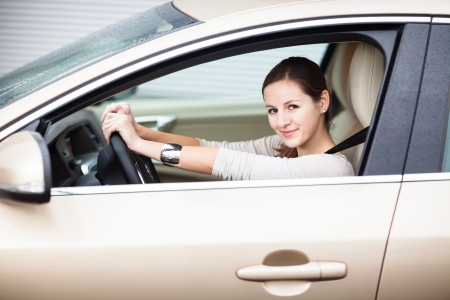 Pretty young woman driving her new car Stock Photo - 17038400
