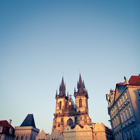 tynsky church: View of the Church of Our Lady (Tyn Church) and the houses of the Old Town Square in Prague at dusk Stock Photo