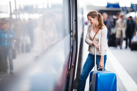 station wagon: Pretty young woman at a train station Stock Photo