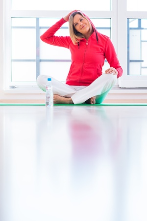 kneel: Pretty young woman doing YOGA exercise at home