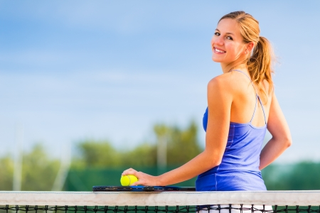 Portrait of a pretty young tennis player with copyspace Stock Photo - 17134105