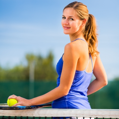 Portrait of a pretty young tennis player with copyspace Stock Photo - 17134324