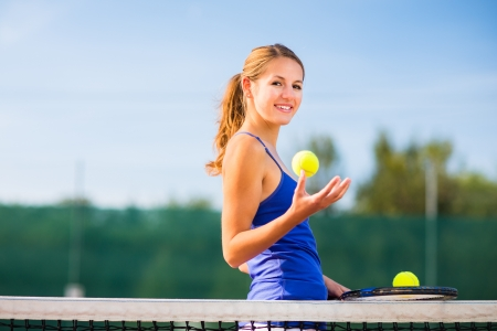 Portrait of a pretty young tennis player with copyspace Stock Photo - 17134354