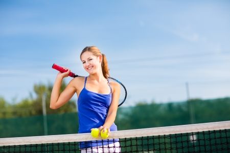 Portrait of a pretty young tennis player with copyspace Stock Photo - 17134373