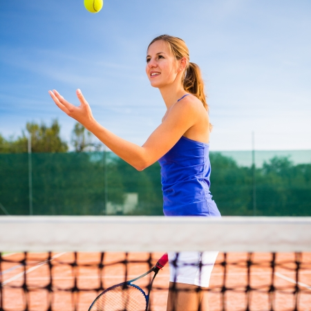 Portrait of a pretty young tennis player Stock Photo - 17134333