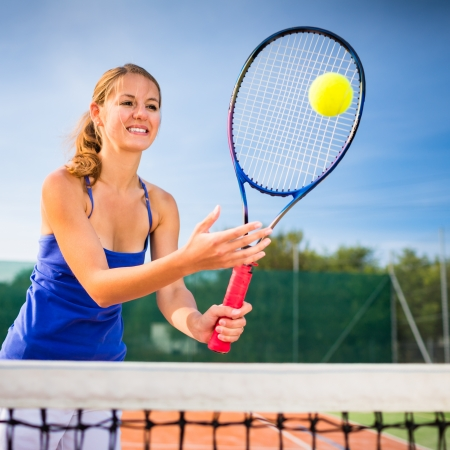 Portrait of a pretty young tennis player Stock Photo - 17134328