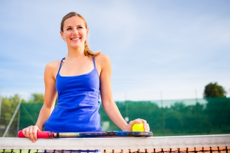 Portrait of a pretty young tennis player with copyspace Stock Photo - 17134347