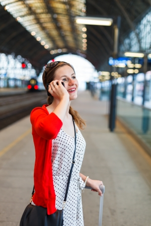 Pretty young woman at a train station Stock Photo - 17256234