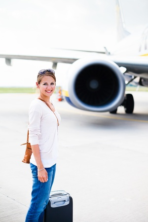 Just arrived: young woman at an airport having just left the aircraft Stock Photo - 17628164