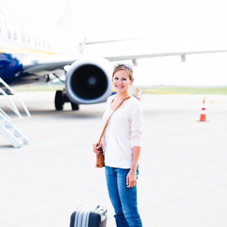 Just arrived: young woman at an airport having just left the aircraft Stock Photo - 17628134