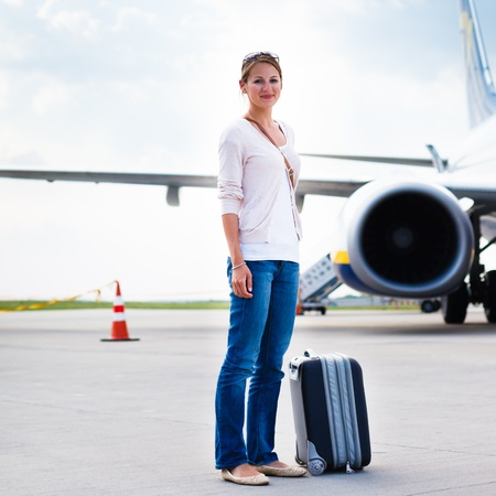 Just arrived: young woman at an airport having just left the aircraft Stock Photo - 17628113