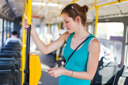 traffic ticket: Pretty, young woman on a streetcartramway Stock Photo