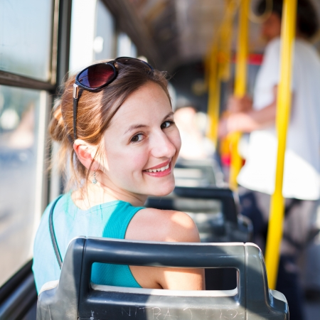 bus stop: Pretty, young woman on a streetcartramway Stock Photo