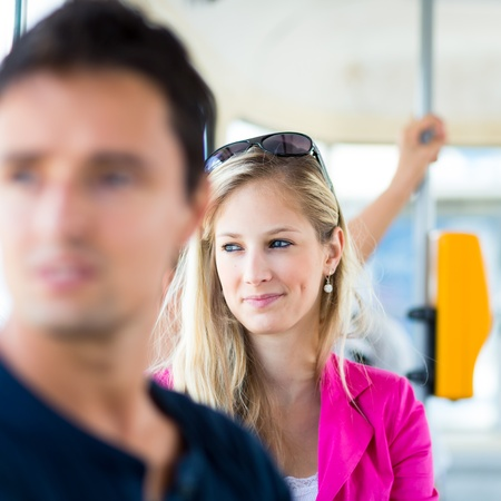 Pretty, young woman on a streetcartramway photo