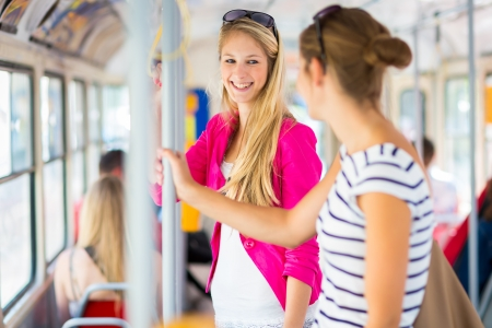 Pretty, young woman on a streetcartramway Imagens