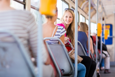 trams: Pretty, young woman on a streetcartramway Stock Photo