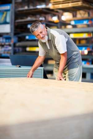 Man buying construction wood in a  DIY store photo