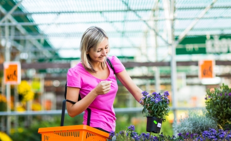 Young woman buying flowers at a garden center Stock Photo - 17692678