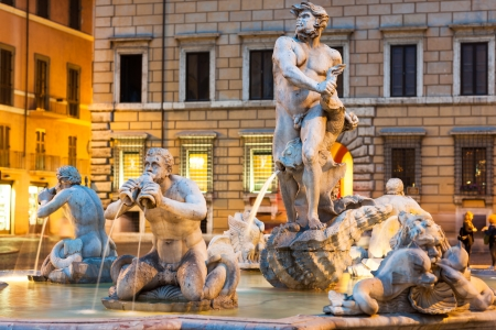 mannerism: Northward view of the Piazza Navona with the fontana del Moro (the Moor Fountain) and the SantAgnese in Agone church at dusk - Rome, Italy