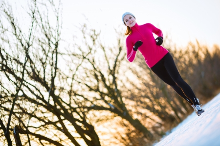 cold woman: Young woman running outdoors on a cold winter day Stock Photo