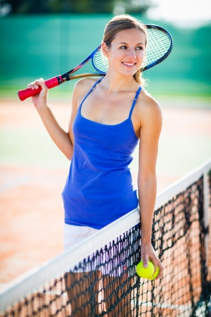 Portrait of a pretty young tennis player photo