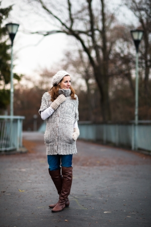 Autumn/winter portrait: young woman dressed in a warm woolen cardigan posing outside in a city park Stock Photo - 17885222