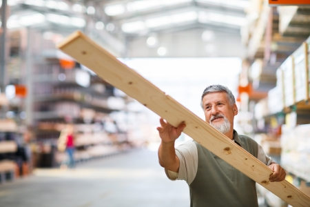 home builder: Senior man buying construction wood in a  DIY store