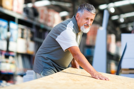 factory floor: Senior man buying construction wood in a  DIY store