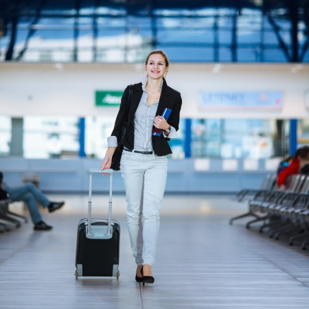passports: Pretty young female passenger at the airport