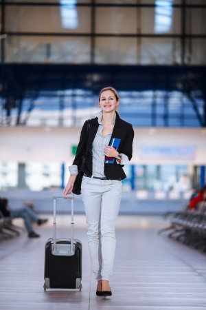 passenger plane: Pretty young female passenger at the airport