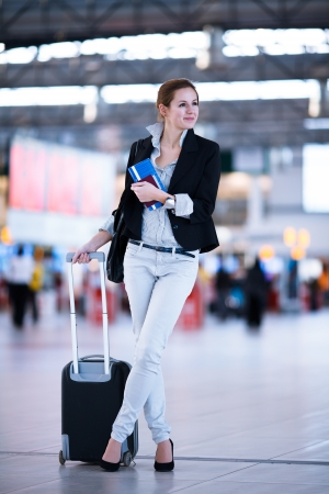 arrive: Pretty young female passenger at the airport