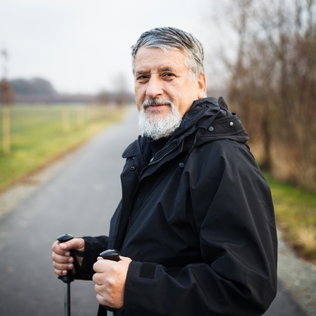 Senior man nordic walking, enjoying the outdoors Stock Photo - 18907248