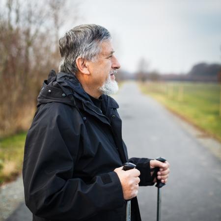 action fund: Senior man nordic walking, enjoying the outdoors