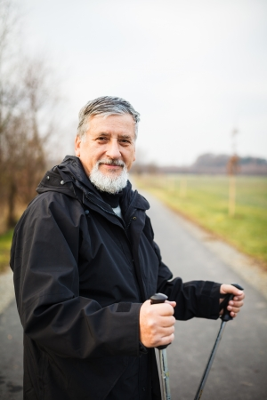 Senior man nordic walking, enjoying the outdoors Stock Photo - 18907948