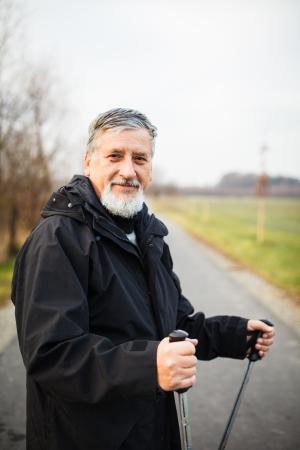 Senior man nordic walking, enjoying the outdoors Stock Photo - 18907948