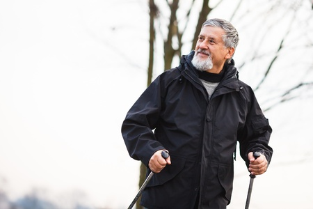 Senior man nordic walking, enjoying the outdoors Stock Photo - 18907112