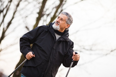 Senior man nordic walking, enjoying the outdoors Stock Photo - 18907673