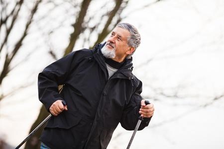 Senior man nordic walking, enjoying the outdoors Stock Photo - 18907673