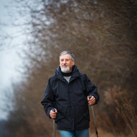 Senior man nordic walking, enjoying the outdoors Stock Photo - 18907180