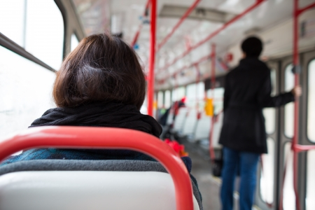 Public transport series - taking a tram commute to work school  color toned image; shallow DOF  Stock Photo