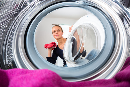 bright housekeeping: young woman doing laundry