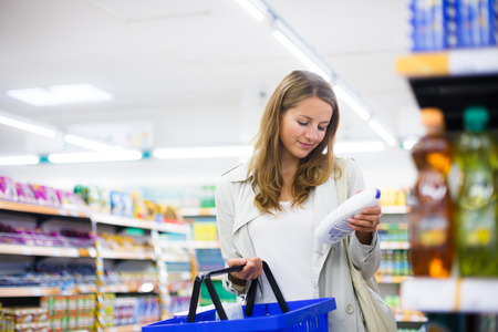 produce sections: Beautiful young woman shopping in a grocery storesupermarket Stock Photo