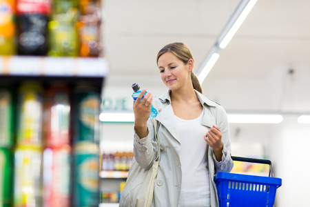 produce sections: Beautiful young woman shopping in a grocery storesupermarket