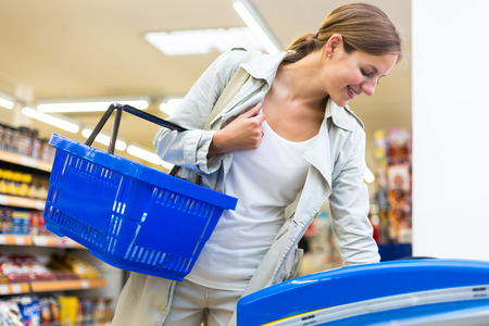 Beautiful young woman shopping in a grocery storesupermarket  photo
