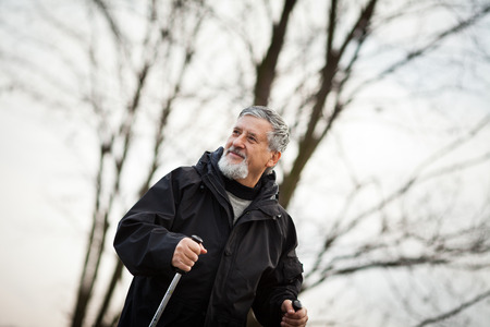 Senior man nordic walking, enjoying the outdoors, the fresh air, getting the necessary exercise Stock Photo - 25783209