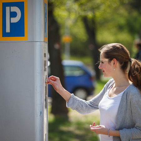 vending machine: Young woman paying for parking