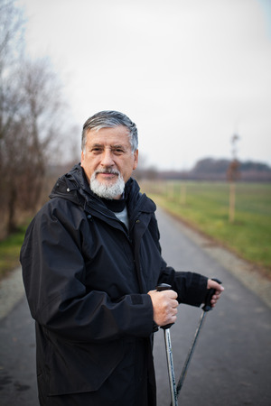 action fund: Senior man nordic walking, enjoying the outdoors, the fresh air, getting the necessary exercise Stock Photo