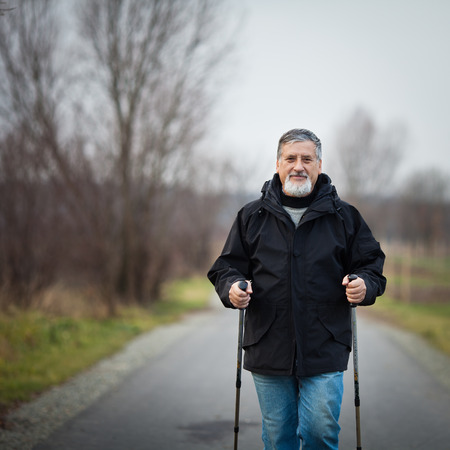 Senior man nordic walking, enjoying the outdoors, the fresh air, getting the necessary exercise Stock Photo - 25817546